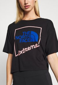 The North Face - EXTREME CROP TEE - Print T-shirt - black - 5
