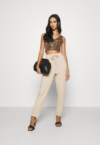 KENDALL + KYLIE - Tracksuit bottoms - beige - 1