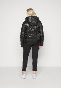 Calvin Klein Jeans Plus - SHINY SHORT PUFFER - Winter jacket - black - 2