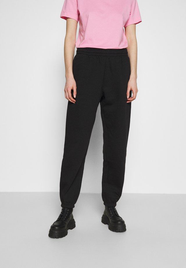 CORINNA  - Spodnie treningowe - black