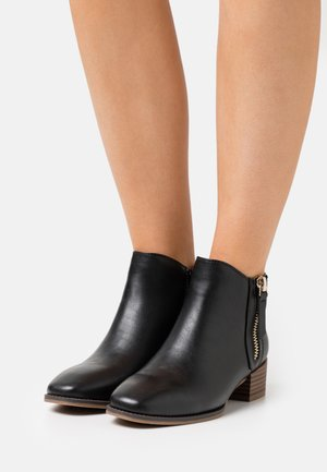 DIXIEE - Kotníková obuv - black