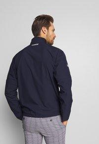 Lacoste Sport - HIGH PERFORMANCE JACKET - Waterproof jacket - navy blue/white - 3