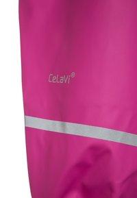 CeLaVi - RAINWEAR PANTS SOLID UNISEX - Rain trousers - real pink - 3