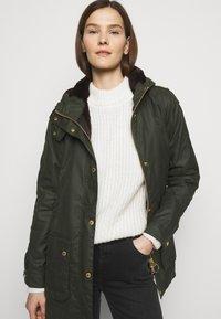 Barbour - AUSTEN WAX - Light jacket - dark green - 4