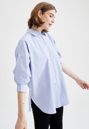 OVERSIZE FIT  - Button-down blouse - blue