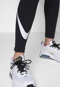 Nike Sportswear - Leggings - Trousers - black/white - 5