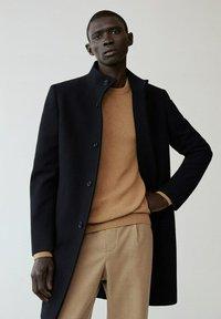 Mango - FUNNEL-I - Classic coat - schwarz - 0