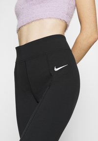 Nike Sportswear - LEGASEE  - Leggings - black - 6