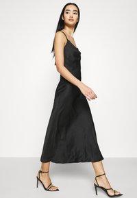 Vero Moda - VMCENTURY OPEN BACK DRESS - Společenské šaty - black - 4