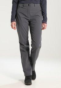 Jack Wolfskin - ACTIVATE LIGHT PANTS WOMEN - Kalhoty - dark iron - 0