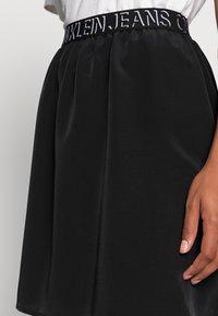 Calvin Klein Jeans - LOGO WAISTBANDSKIRT - Mini skirt -  black - 4