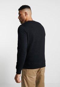 Jack & Jones - JJECHEST LOGO CREW NECK - Sweatshirt - black - 0