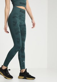 Puma - EVOKNIT SEAMLESS LEGGINGS - Tights - ponderosa pine - 0