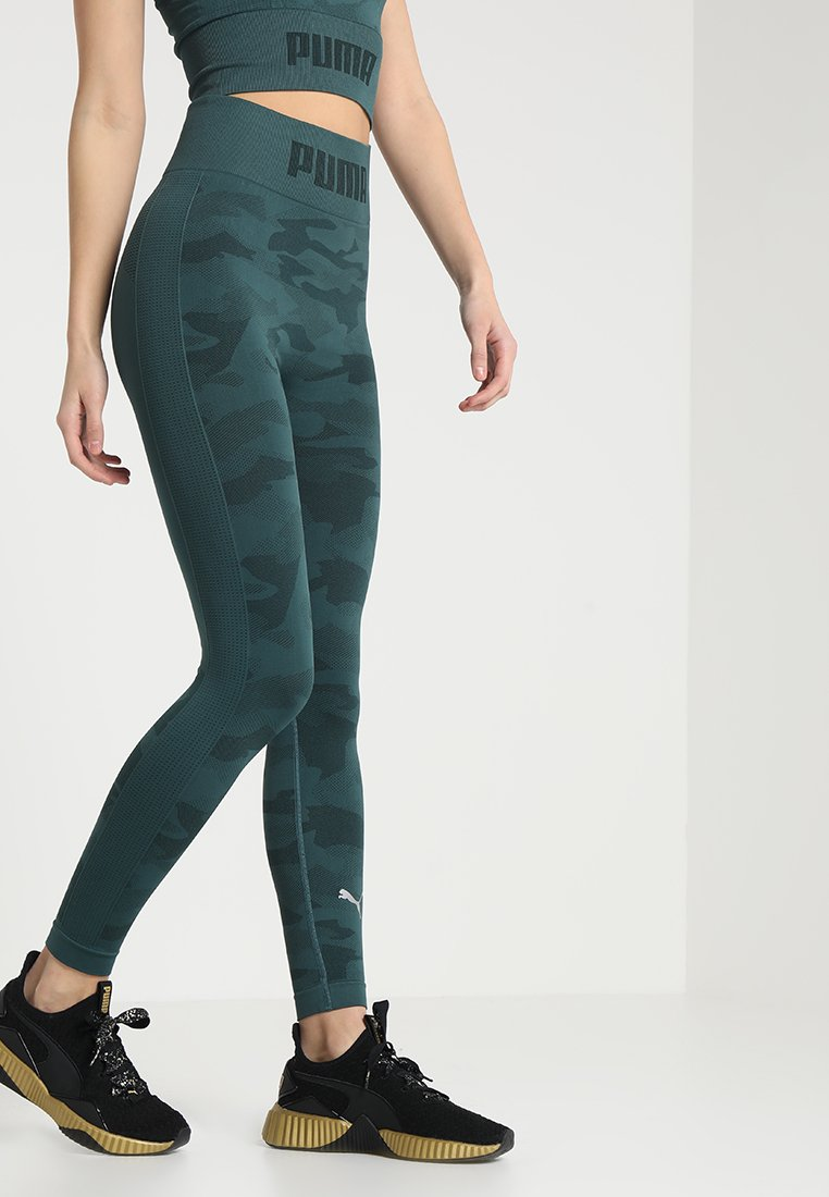 Puma - EVOKNIT SEAMLESS LEGGINGS - Tights - ponderosa pine