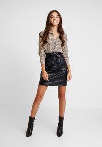 Vero Moda - VMEVA PAPERBAG SHORT SKIRT - Mini skirt - black - 1