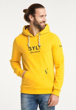 SYLT - Huppari - senf