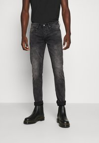Tigha - MORTY STONE WASH - Slim fit jeans - vintage black - 0