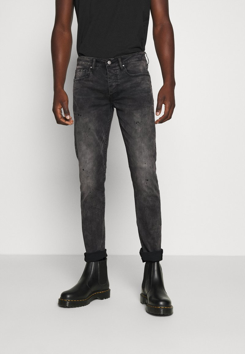 Tigha - MORTY STONE WASH - Slim fit jeans - vintage black