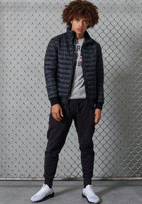 Superdry - Winter jacket - black - 0