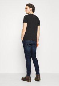 Diesel - D-LUSTER - Slim fit jeans - dark blue - 2
