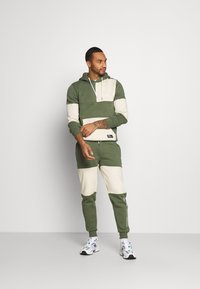 Redefined Rebel - DAWSON  - Tracksuit bottoms - thyme - 1