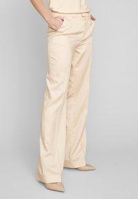 ECHTE - Trousers - pale peach - 0
