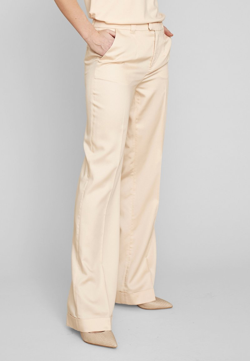 ECHTE - Trousers - pale peach