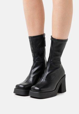 UPTAKE - High heeled ankle boots - black