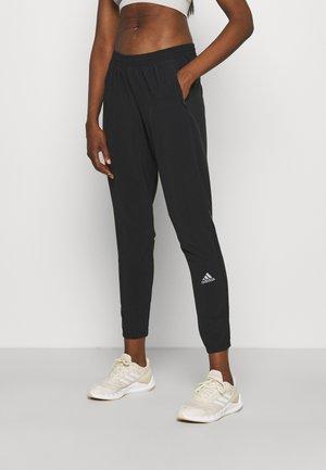 CONFIDENT PANT - Teplákové kalhoty - black