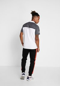 Lacoste Sport - PANT TAPERED - Tracksuit bottoms - black/corrida - 2