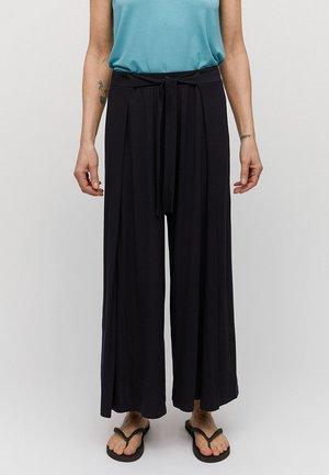 KAROLINAA - Trousers - black