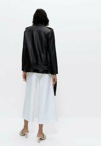Uterqüe - Leather jacket - black - 2