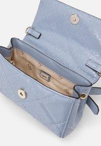Guess - DILLA XBODY BELT BAG - Across body bag - chambray - 2