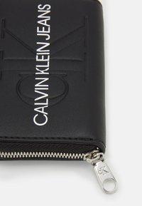 Calvin Klein Jeans - ACCORDION ZIP AROUND - Wallet - black - 3