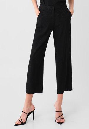 SKULL STAR PANT - Trousers - black