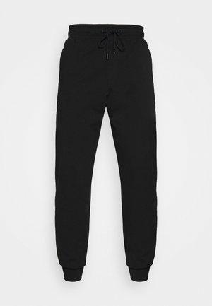 ADAM PANT - Pantalon de survêtement - jet black