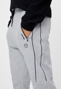 Bershka - REFLEKTIERENDE - Tracksuit bottoms - light grey - 3