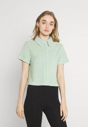 ANYWHERE - Button-down blouse - pistachio