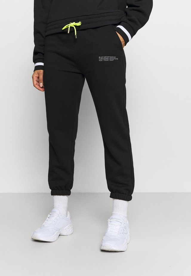 SIGNATURE - Tracksuit bottoms - black