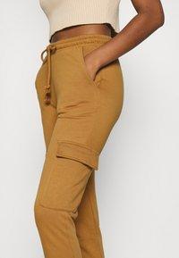 Vero Moda - VMMERCY PANT - Tracksuit bottoms - tobacco brown - 4