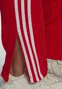 adidas Originals - PRIMEBLUE SST - Tracksuit bottoms - red - 3