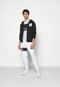 Polo Ralph Lauren - DOUBLE TECH - Tracksuit bottoms - white - 1