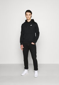Nike Sportswear - REPEAT HOODIE - Long sleeved top - black/reflective silver - 1