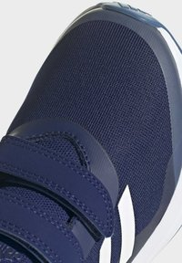 adidas Performance - FORTARUN - Stabilty running shoes - blue - 5