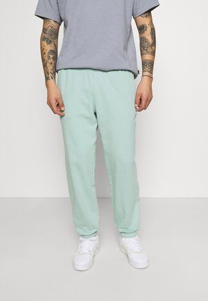 PREMIUM UNISEX - Tracksuit bottoms - hazy green
