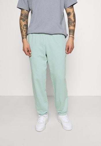 PREMIUM UNISEX - Pantalon de survêtement - hazy green