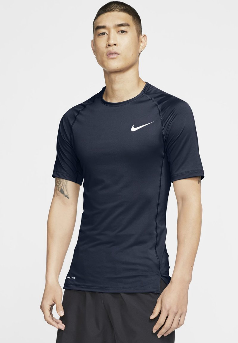 Nike Performance - Basic T-shirt - obsidian/white