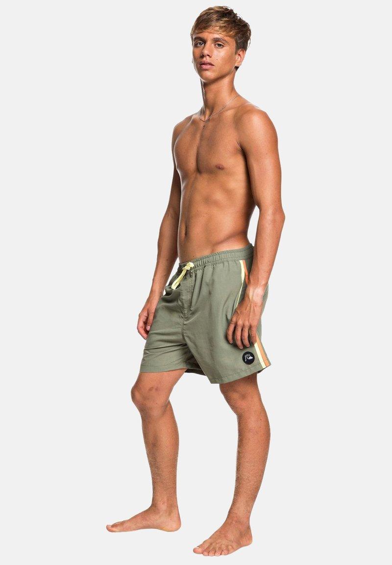 Quiksilver - Swimming shorts - green