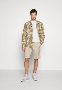 Carhartt WIP - MASTER DENISON - Shorts - wall rinsed - 1