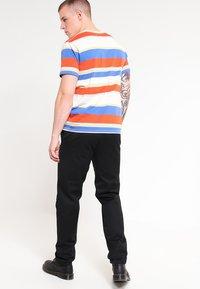 Carhartt WIP - MASTER PANT DENISON - Spodnie materiałowe - black rinsed - 2